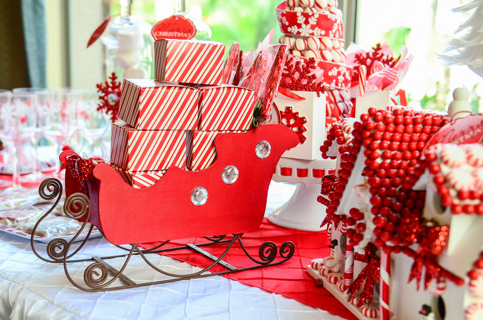 Kids christmas party decorations - Santas Sled With Presents And A White And Red Gingerbread House For A Kids Christmas Party