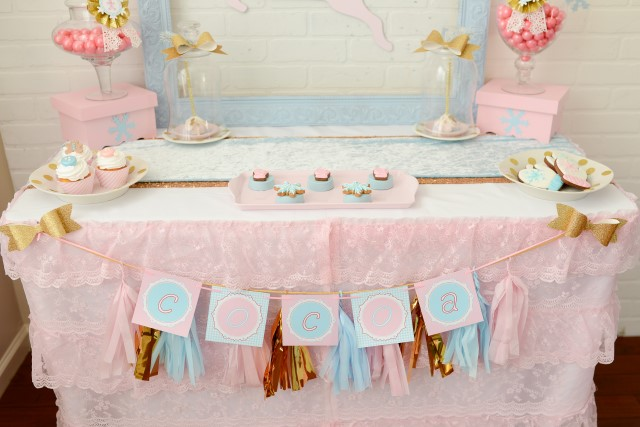 cocoa banner with pink and blue and gold tassels for a christmas party