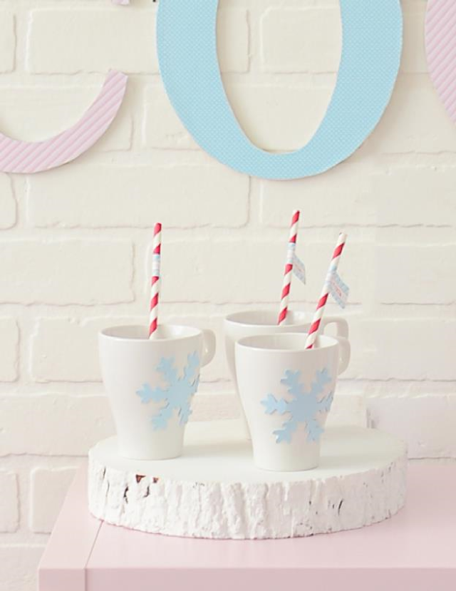 snowflake cocoa mug with paper straws and straw flags