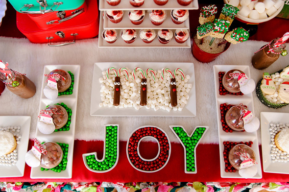 diy hot chocolate christmas ornaments on display with christmas desserts for a holiday party