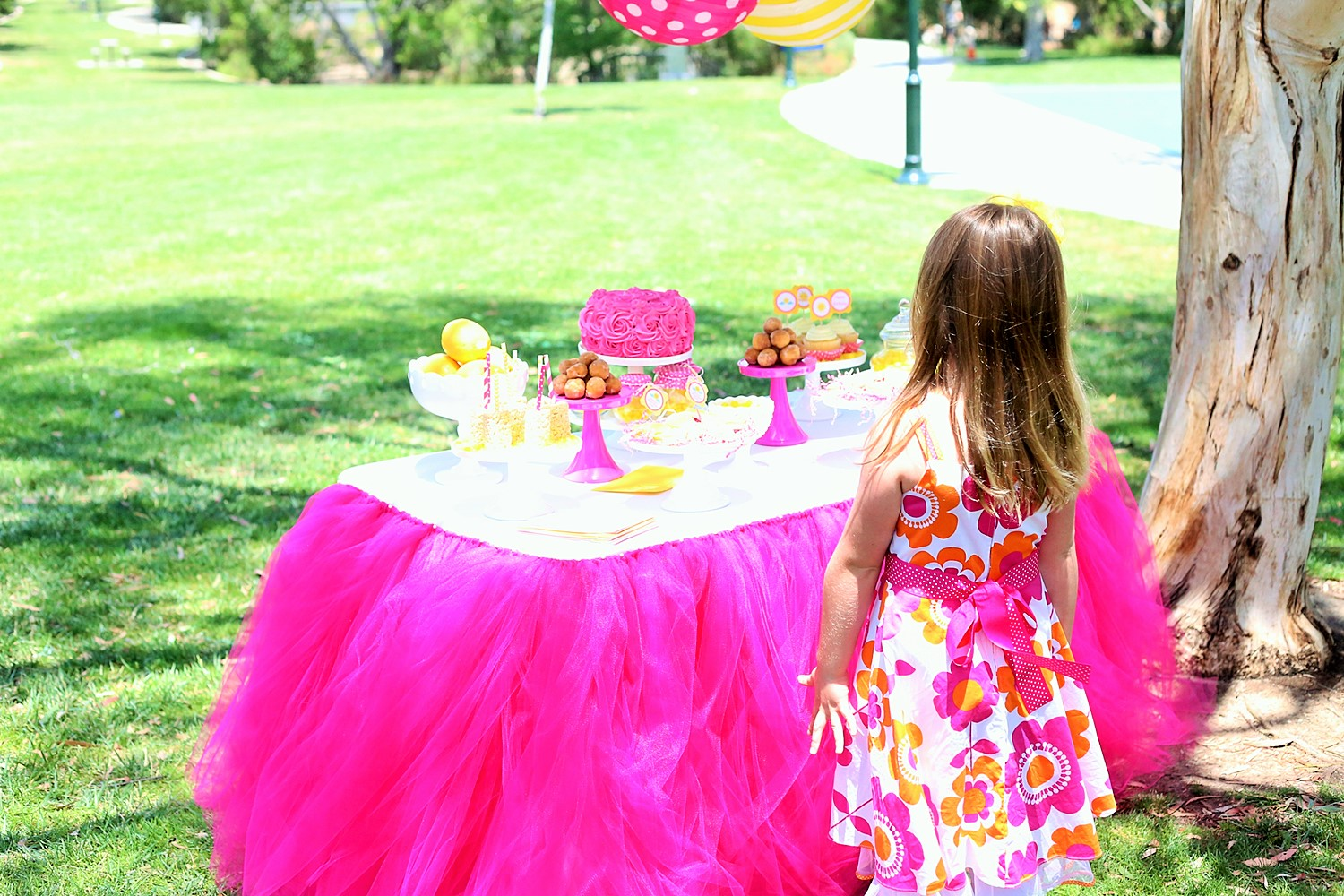 sunshine and lemonade party with custom table skirt and sweets