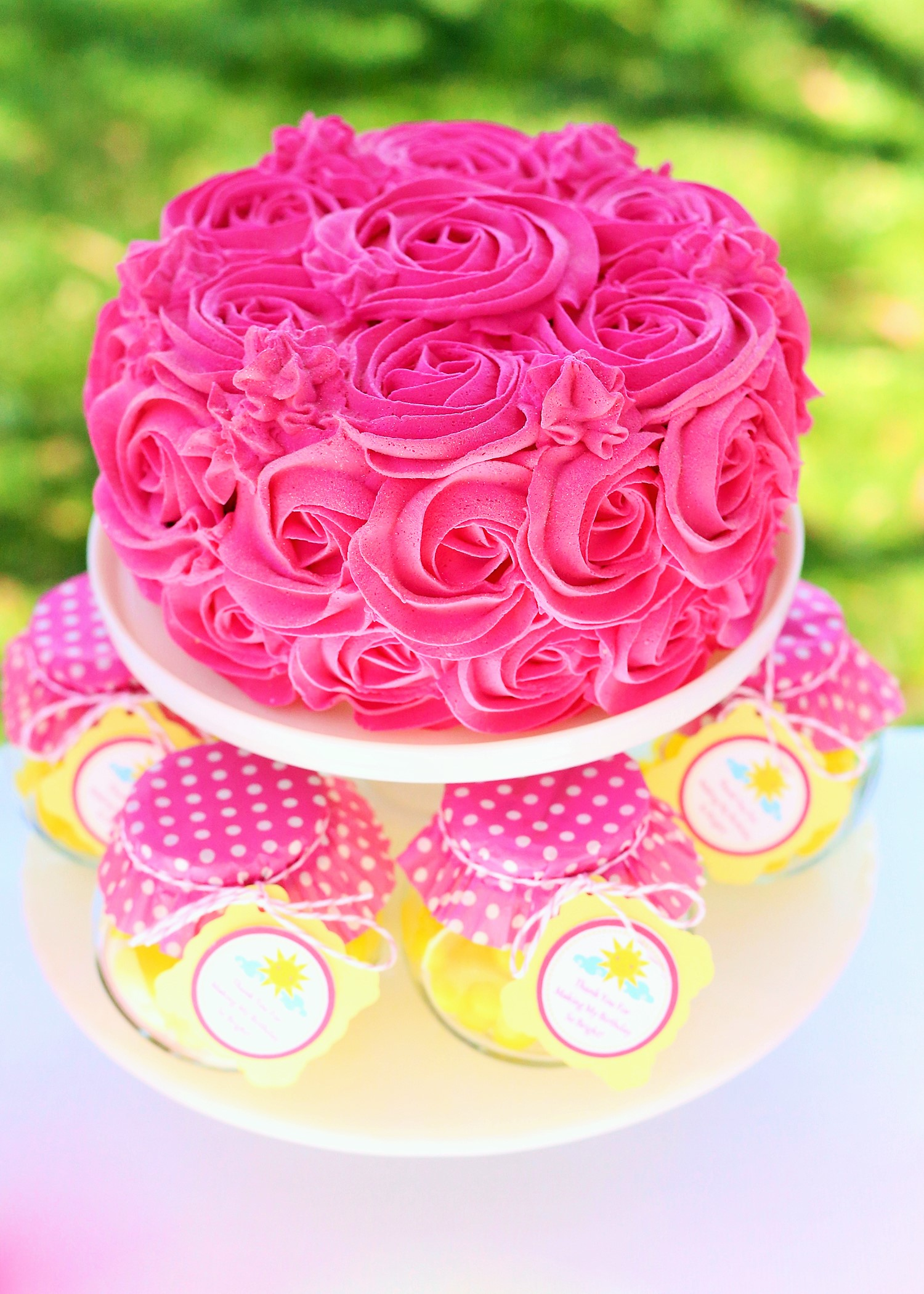 sunshine and lemonade party rosette cake and party favors