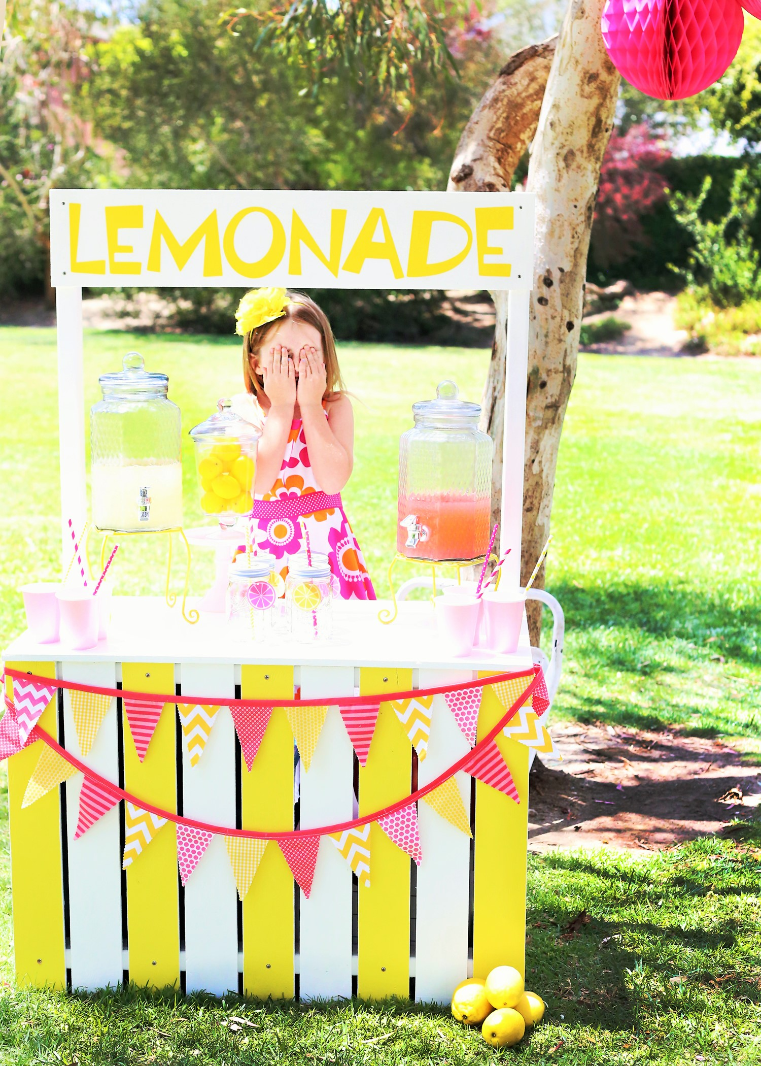 sunshine and lemonade party with lemonade stand