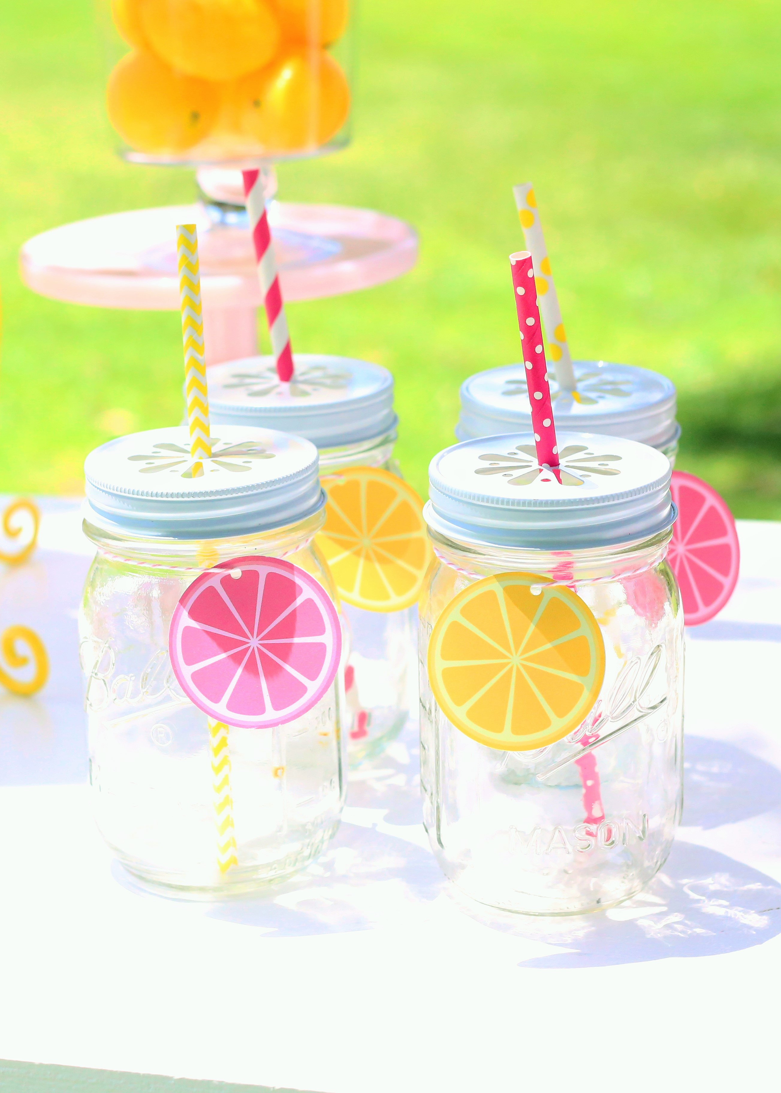 sunshine and lemonade party mason jars with pink and yellow lemon slice printables an paper straws
