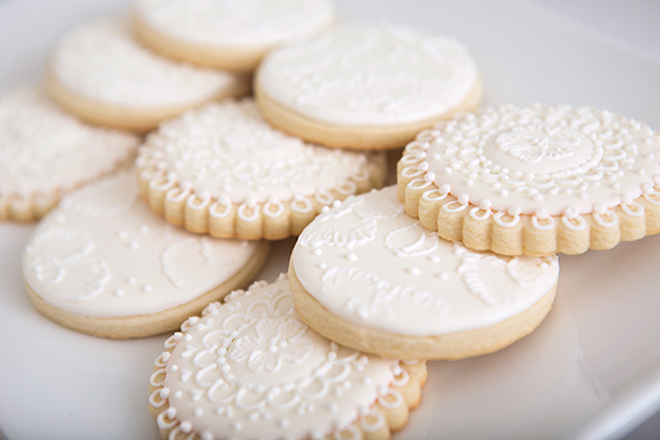 white lace inspired cookies for a lace pearls bridal shower