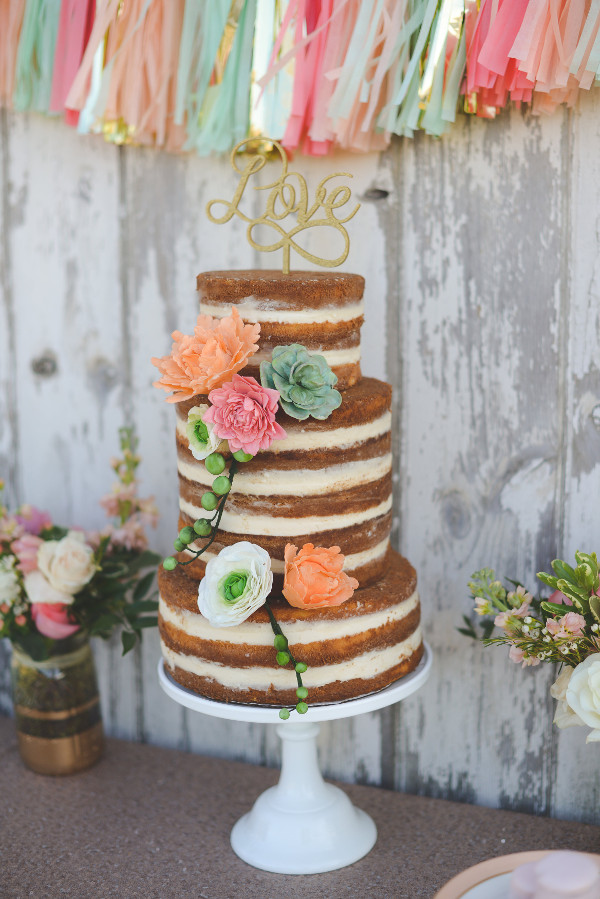 rustic glam wedding cake with gold cake topper and tassels