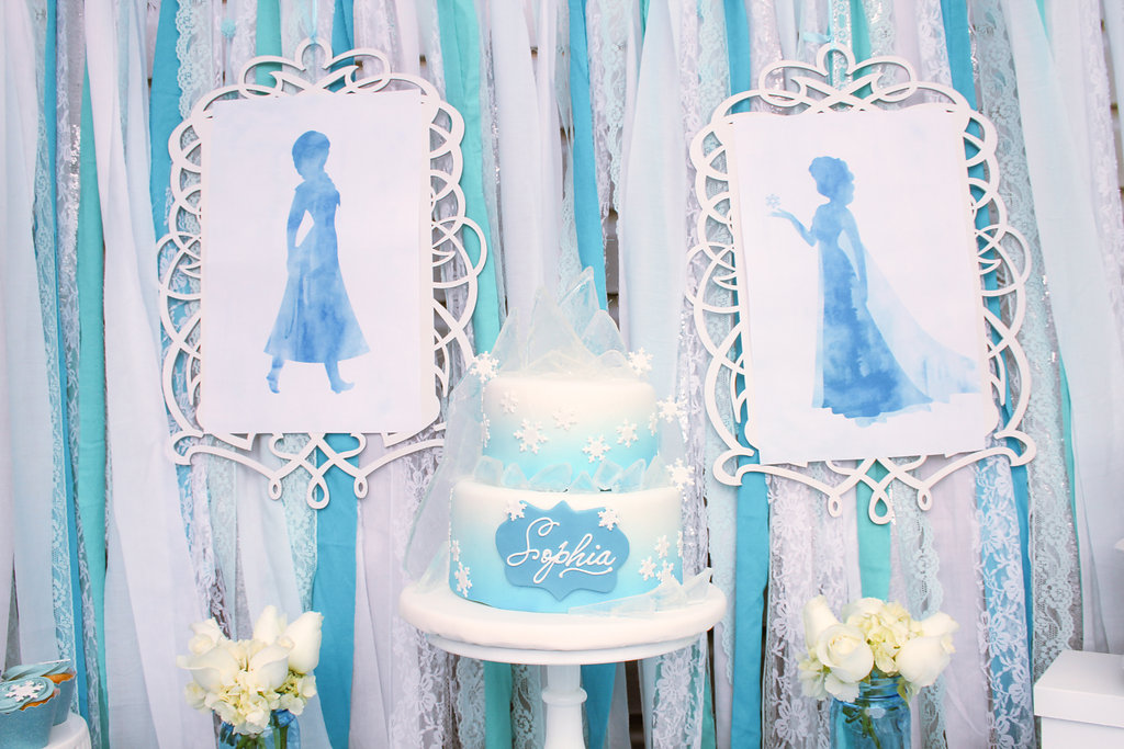sweetly chic events & design frozen party water color and ribbon backdrop with frozen cake