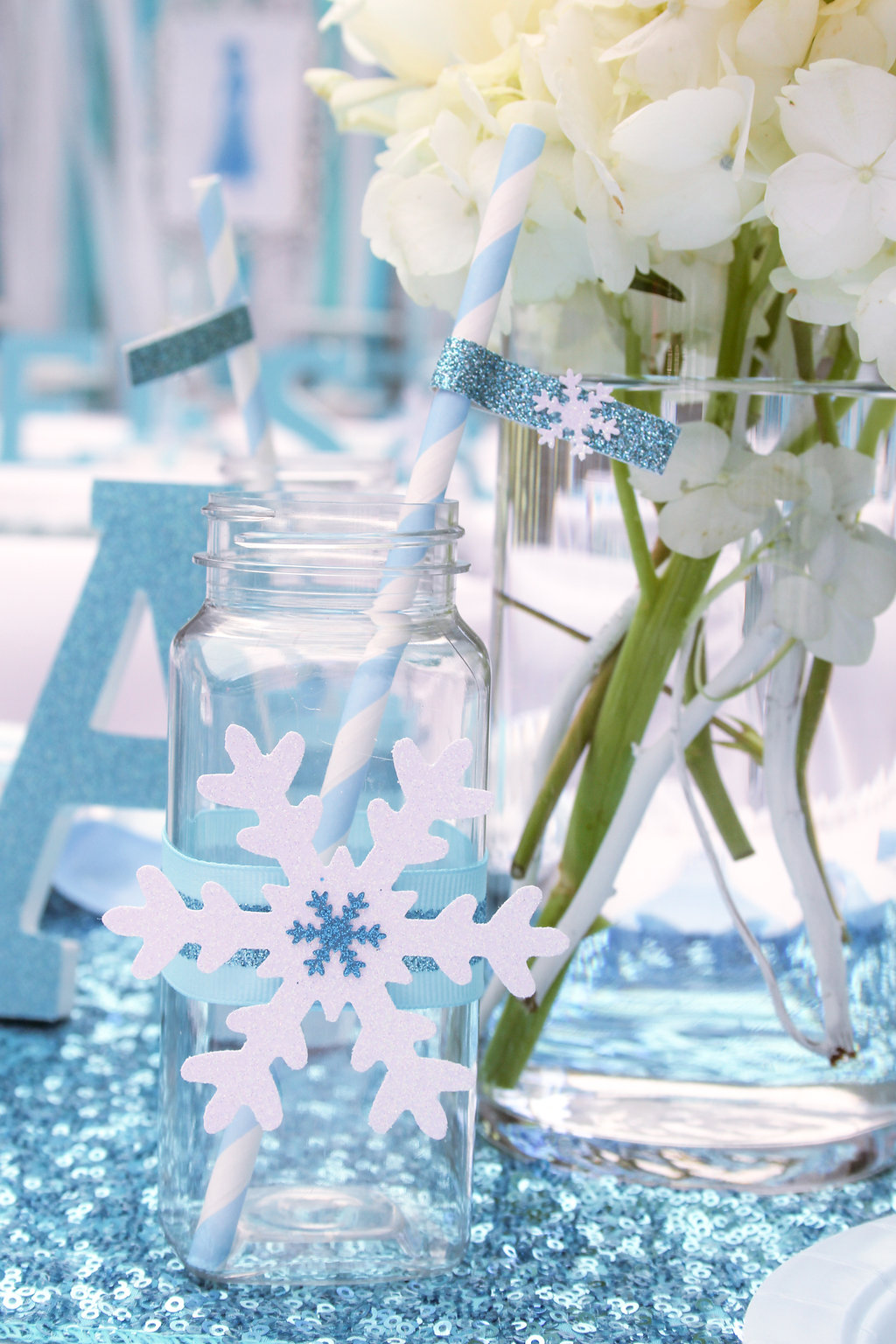 sweetly chic events & design frozen party drink bottles and straws with straw flags