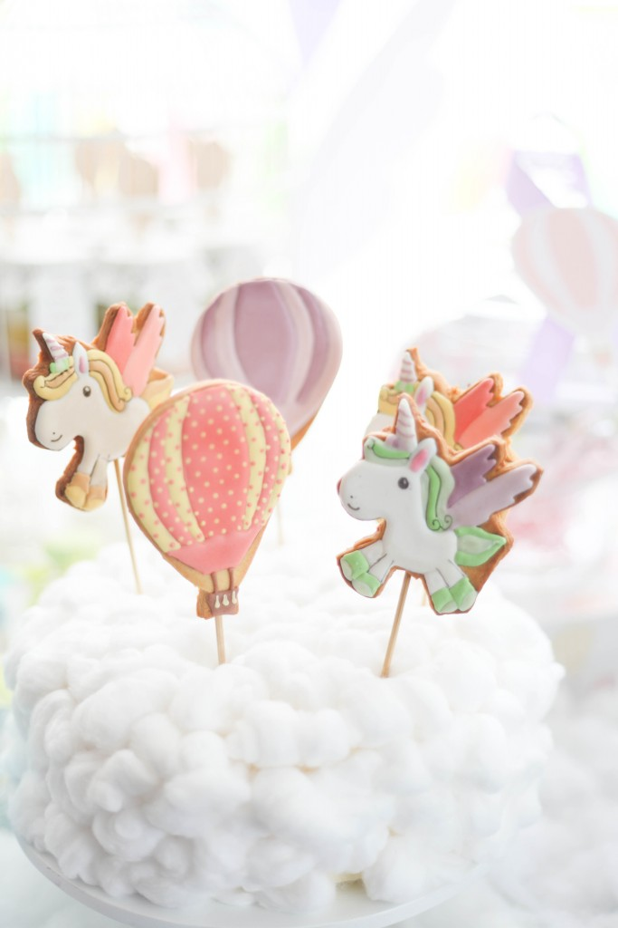hot air balloon, rainbow unicorn first birthday party table cookies