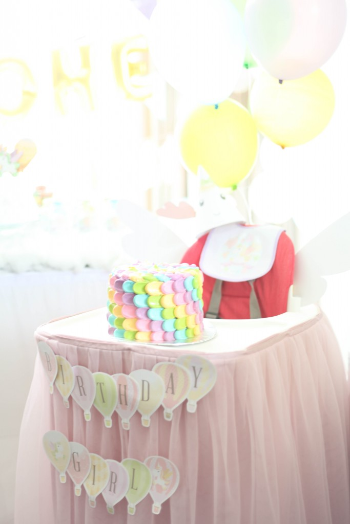 hot air balloon, rainbow unicorn first birthday party smash cake