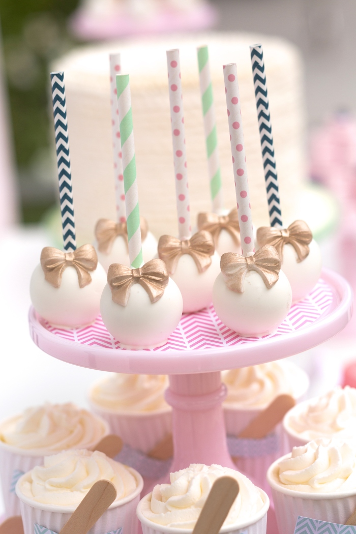 bow and arrow themed birthday party cake pops